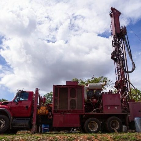 truck used to drill a hole in the ground for a well